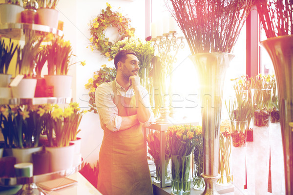 florist man or seller at flower shop Stock photo © dolgachov