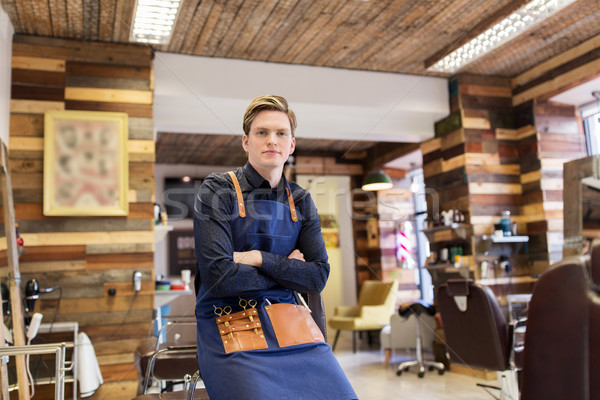 male hairdresser at hair salon or barbershop Stock photo © dolgachov