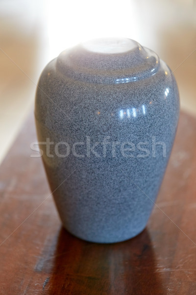 Stock photo: cremation urn on table