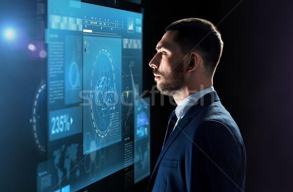 Affaires regarder écran noir gens d'affaires Photo stock © dolgachov