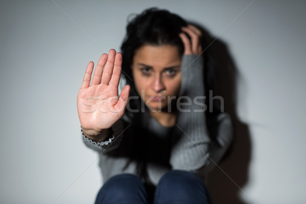 unhappy crying woman showing defensive gesture Stock photo © dolgachov