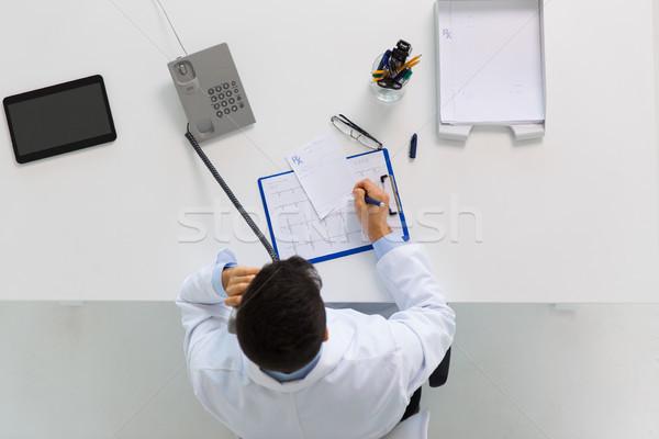 doctor with prescription calling on phone Stock photo © dolgachov