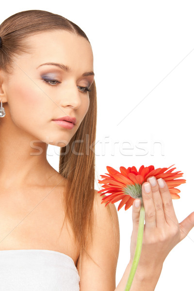 lovely woman with red flower Stock photo © dolgachov