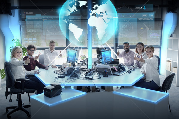 Boldog üzleti csapat Föld hologram iroda globális Stock fotó © dolgachov