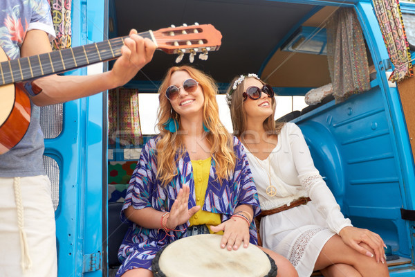 Feliz hippie amigos jugando música Foto stock © dolgachov