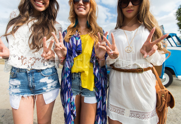 smiling young hippie women showing peace sign Stock photo © dolgachov