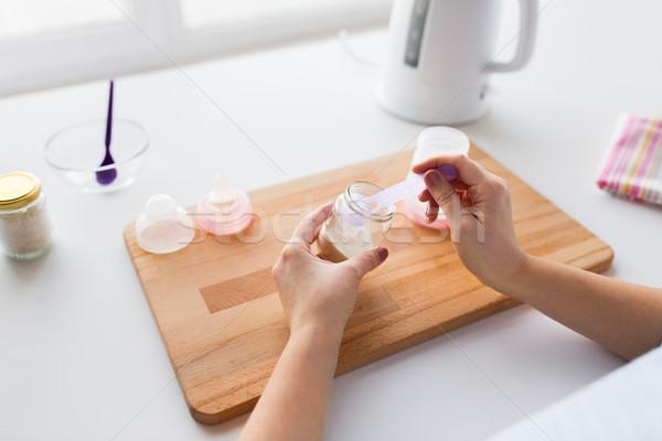 hands with infant formula making baby milk Stock photo © dolgachov