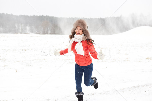 happy woman in winter fur hat having fun outdoors Stock photo © dolgachov