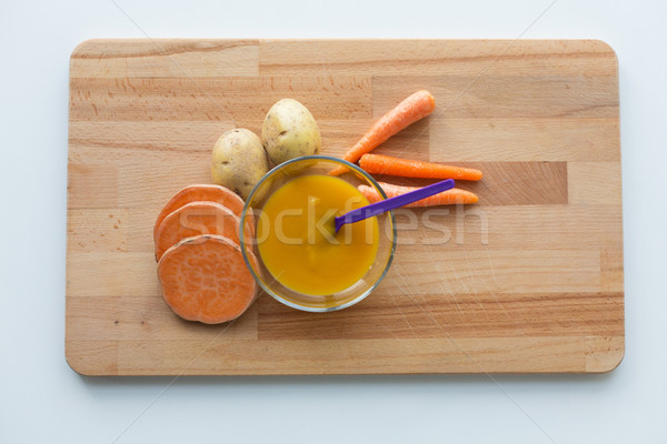vegetable puree or baby food in bowl with spoon Stock photo © dolgachov