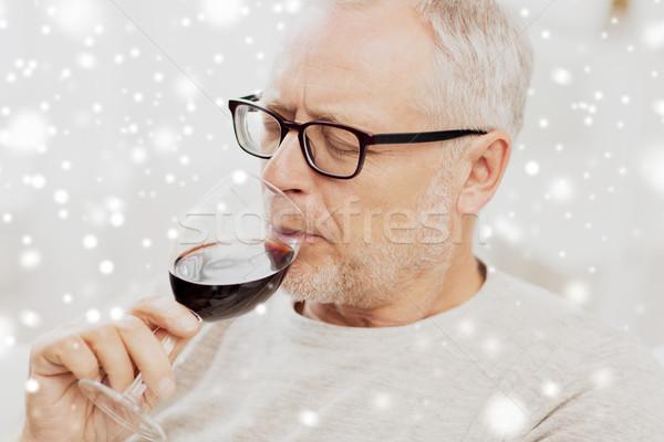 senior man drinking red wine from glass Stock photo © dolgachov