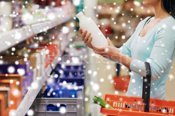 woman with milk bottle at grocery or supermarket Stock photo © dolgachov