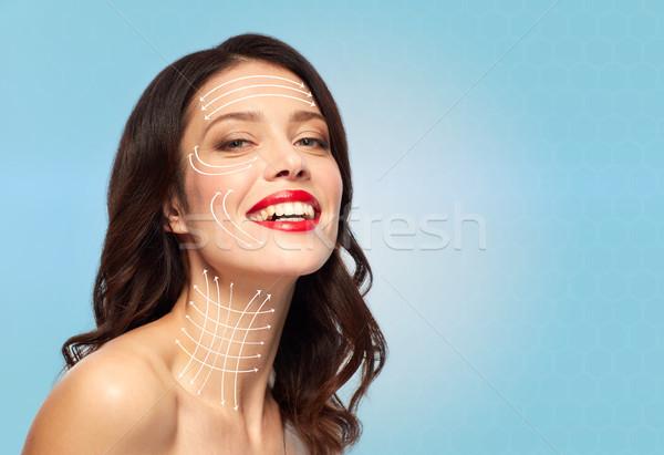 Vrouw pijlen gezicht nek huid Stockfoto © dolgachov