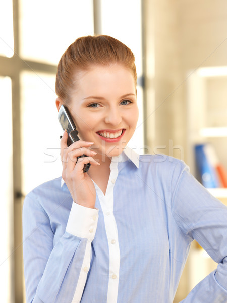 businesswoman with cell phone Stock photo © dolgachov