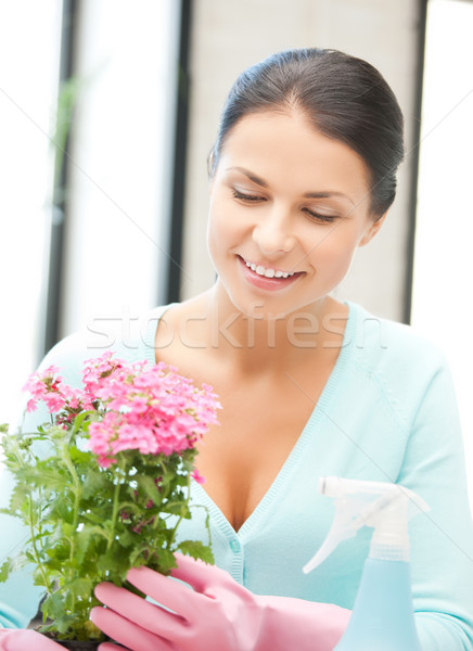 woman holding pot with flower and spray bottle Stock photo © dolgachov
