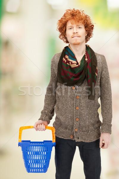 man with shopping cart Stock photo © dolgachov