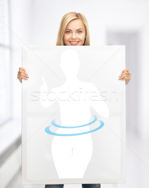 woman holding picture of dieting woman Stock photo © dolgachov