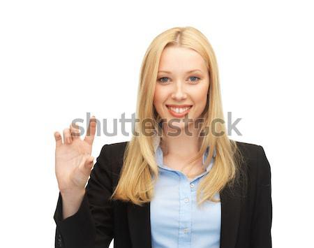 деловая женщина что-то мнимый фотография красивой Сток-фото © dolgachov