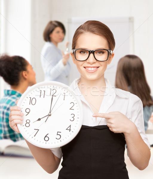 Atraente estudante indicação relógio educação Foto stock © dolgachov