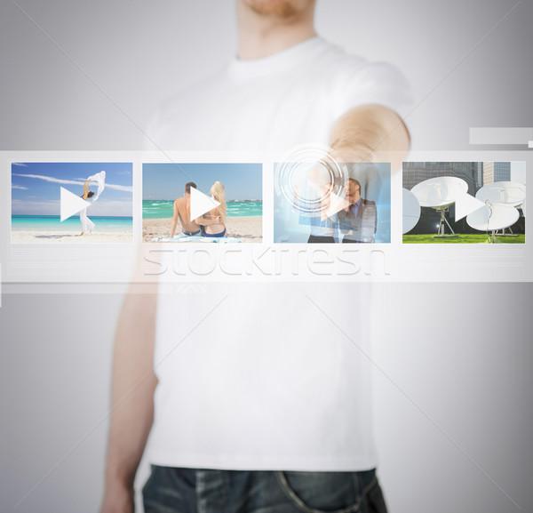 man pressing button on virtual screen Stock photo © dolgachov