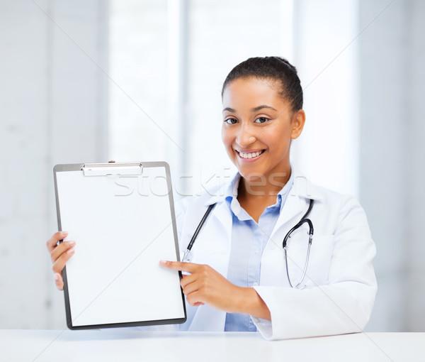 Médico prescrição médico feminino estetoscópio Foto stock © dolgachov