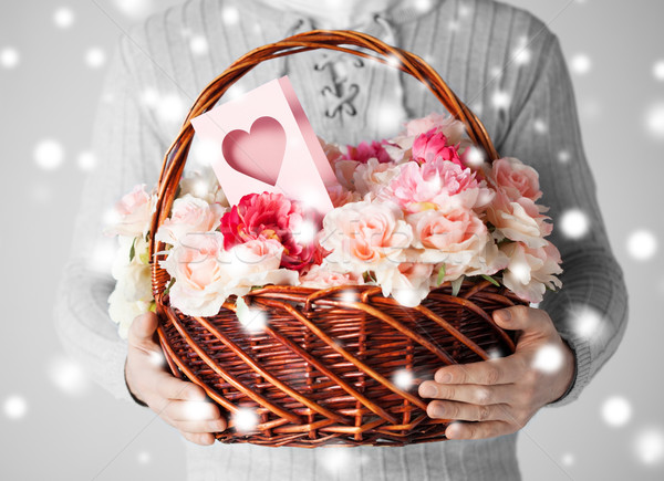 Homme panier plein fleurs carte postale Photo stock © dolgachov