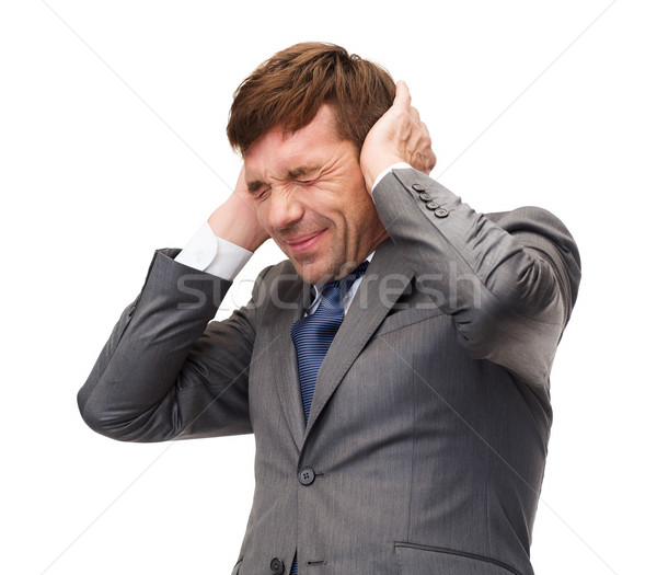 stressed buisnessman or teacher closing ears Stock photo © dolgachov
