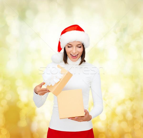 surprised woman in santa helper hat with gift box Stock photo © dolgachov