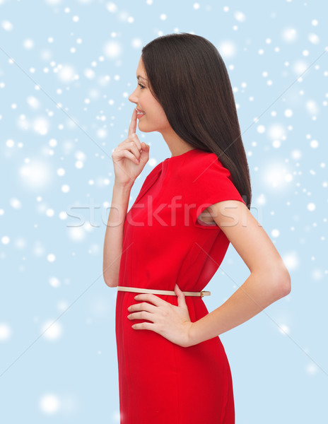 young woman in red dress choosing Stock photo © dolgachov