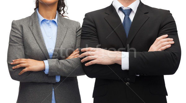 businesswoman and businessman with crossed arms Stock photo © dolgachov