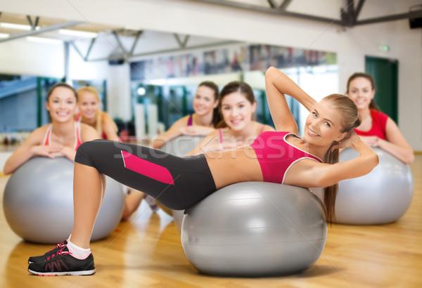 smiling female instructor with fitness ball Stock photo © dolgachov