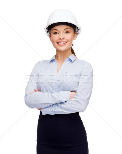 Vriendelijk glimlachend zakenvrouw witte helm gebouw Stockfoto © dolgachov