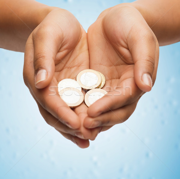 Stock photo: womans cupped hands showing euro coins