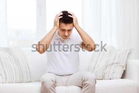 sad man watching sports at home Stock photo © dolgachov