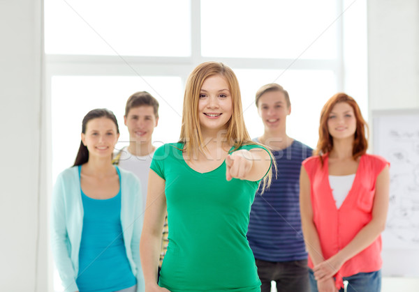 students with teenager in front pointing at you Stock photo © dolgachov