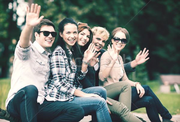group of students or teenagers waving hands Stock photo © dolgachov