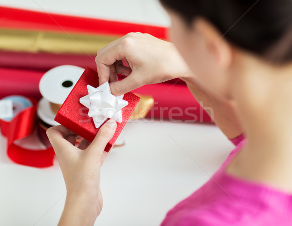 Stock photo: close up of woman decorating christmas presents