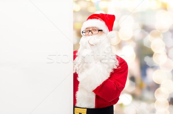 man in costume of santa claus with billboard Stock photo © dolgachov