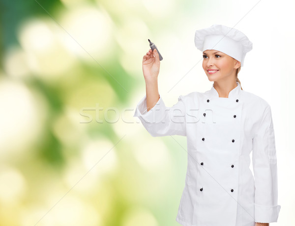 Sonriendo femenino chef escrito algo aire Foto stock © dolgachov