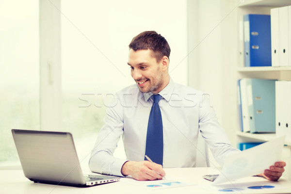 smiling businessman with laptop and documents Stock photo © dolgachov