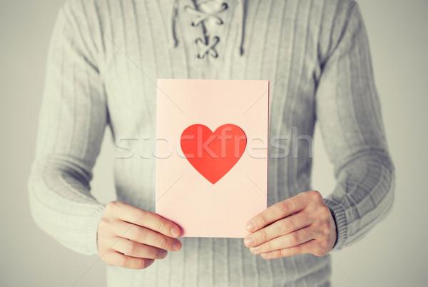 man holding postcard with heart shape Stock photo © dolgachov