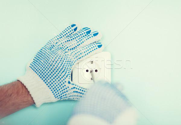 Masculina guantes nuevos enchufe Foto stock © dolgachov