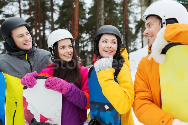 Felice amici caschi parlando inverno tempo libero Foto d'archivio © dolgachov