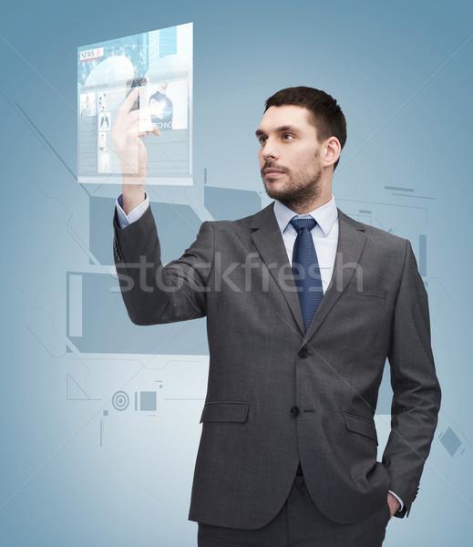 Fiatal üzletember okostelefon üzlet technológia internet Stock fotó © dolgachov