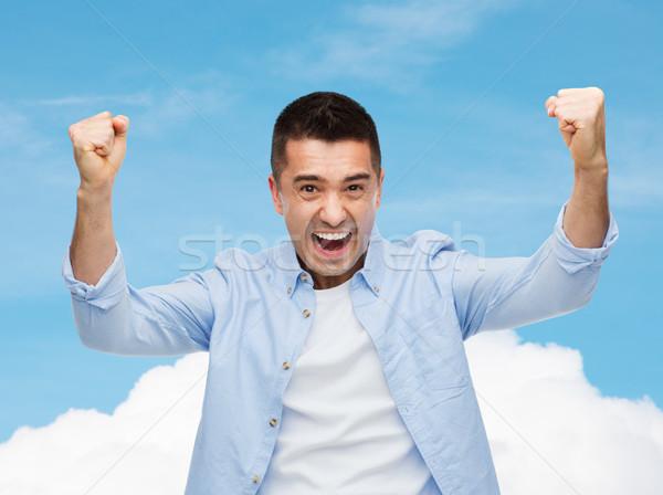 Stok fotoğraf: Mutlu · gülme · adam · kaldırdı · ellerini · mutluluk · jest