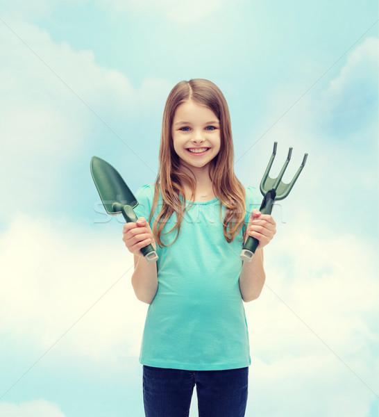 улыбаясь девочку грабли черпать саду люди Сток-фото © dolgachov