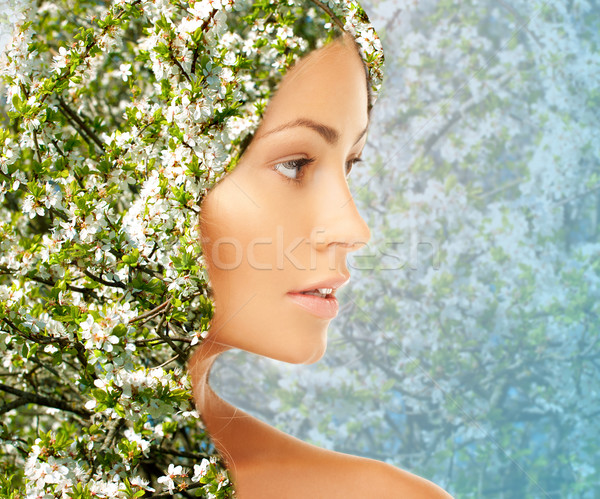 young woman face over blooming tree pattern Stock photo © dolgachov