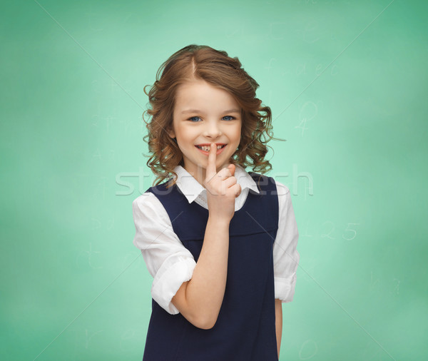 happy girl showing hush gesture Stock photo © dolgachov