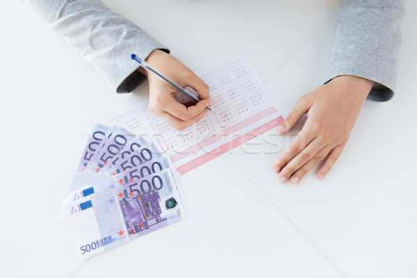 Handen loterij ticket geld business Stockfoto © dolgachov