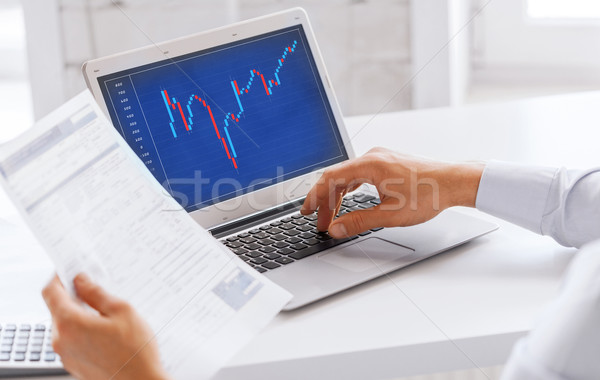 businessman working with forex chart in office Stock photo © dolgachov