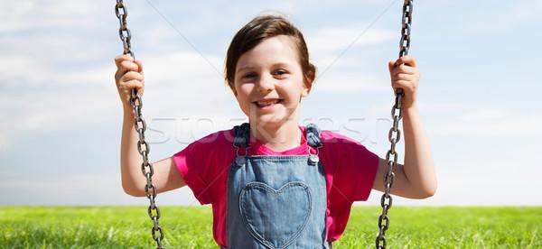 happy little girl swinging on swing outdoors Stock photo © dolgachov